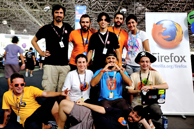 Mozilla community members wearing different t-shirts that mesh well together at the Campus Party Brazil 2014.